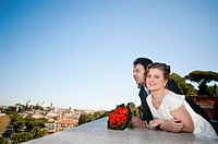 Bride and groom overlooking Rome from the balcony of Giardino degli Aranci, Rome Italy