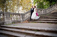 Wedding couple descending stairs Rome Italy