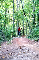 Boy mountain biking at Big Creek Park in Roswell, Georgia USA