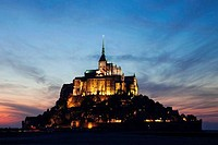 Cathedral lit up at dusk, Mont Saint_Michel, Normandy, France