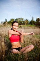Mixed race woman warming up before exercise