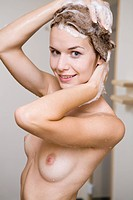 Young woman having shower.