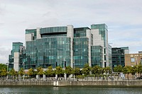 Modern building with glass facade of the AIB Bank in the financial district of Dublin, Ireland, Europe