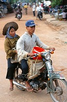 Cambodia, Siem Reap, couple on motorcycle,