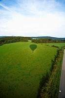 Balloon ride, hot air balloon throwing shadow