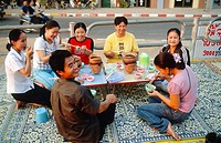 Laos, Vientiane, people eating in the street,