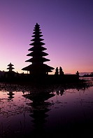 Indonesia, Bali, Candikuning. Meru thatched_roof pagoda of Pura Temple Ulu Danau on Lake Bratan.