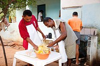 Smallholders plucking a chicken, employment initiative for alcoholics, Crato, state of Pernambuco, Brazil, South America