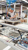 Loewe AG, production of high class television sets, the back of the sets is being equipped with electronic components, Kronach, Bavaria, Germany, Euro...