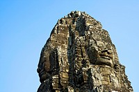Huge stone faces of the Bayon temple, Angkor, Cambodia, Southeast Asia