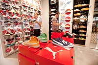 Factory outlet store of the sports goods manufacturer PUMA AG, customers looking at sport shoes, of which many are on sale, Herzogenaurach, Bavaria, G...