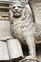 Italy, Venice. Detail of statue of a winged lion with a book on the Doge´s Palace. Credit: Wendy Kaveney / Jaynes Gallery / DanitaDelimont.com