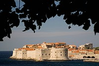Croatia, Dalmatia, Dubrovnik. Adriatic Sea and city walls built 10th century surrounding old town with stone houses. The historic center of Dubrovnik ...