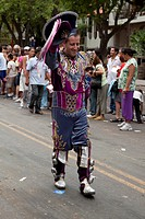 South America, Argentina, Mendoza. Male dancer in colorful costume marches past spectators in the Carrousel of Queens Parade. Credit: Wendy Kaveney / ...