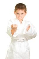 Karate boy makes fists