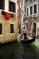 Tourists in a gondola, Venice, Italy, Europe