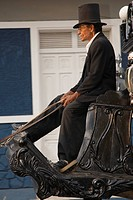 Nicaragua, Granada. Horse_drawn carriage driver.