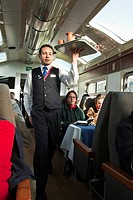 South America, Peru. A train steward prepares to serve breakfast inside a Perurail sky dome train car. UNESCO World Heritage Site Credit: Wendy Kavene...