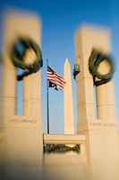 Washington Monument viewed through World War II Memorial blurred, Washington D.C. District of Columbia, United States