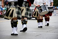 USA, Indiana, Carmel. Kilts and shoes of bagpipers and drummers as they march in a parade. Credit: Wendy Kaveney / Jaynes Gallery / DanitaDelimont.com