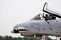 USA, Indiana, Indianapolis, Mount Comfort Airport. A pilot waves to the crowd from an A_10 Thunderbolt II warplane painted with a shark face. Credit: ...