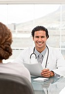 Positive doctor during a appointment with a female patient in his office