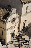 Croatia, Dubrovnik  Pedestrians in front of church of Saint Saviour in old town, seen from city wall