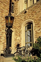 USA, Washington, Seattle, Building, lamppost and bicycles at the University of Washington
