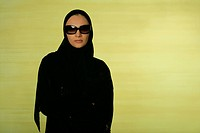 Arab lady wearing eyeglasses looking at the camera