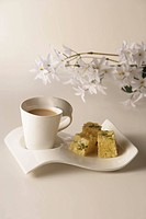 Cups of coffee and indian sweets.