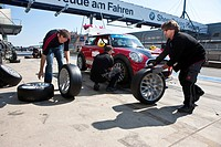 Tyre change, race of the Mini Coopers, Mini Challenge at the Oldtimer Grand Prix 2010, a classic car race, Nuerburgring race track, Rhineland_Palatina...