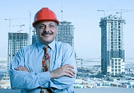 Portrait of a Engineer with the building constructions in the background in Dubai