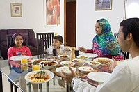 Arab Family of four dining