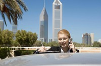 Young Businesswoman outdoors with modern office towers seen in the background