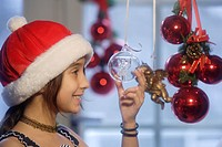 Girl, 12 years, with Christmas decorations