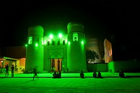 Illuminated entrance to the Ichon Qala Fortress at night, Khiva, Uzbekistan, Central Asia
