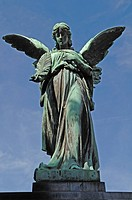 Big statue of an angel on a 19th century family grave against a blue sky, Johannisfriedhof cemetery, founded in the 13th century, Brueckenstrasse stre...