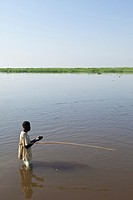 man fishing in Nile River, Bor Sudan, December 2010