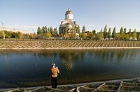 Fisher is fishing in front of an orthodox church, Astana, Kazakhstan, Central Asia
