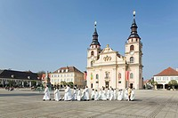 Priest and altar boys on their way to church on the marketplace, Ludwigsburg, Baden-Wuerttemberg, Germany, Europe