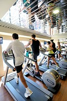 People on treadmills in a gym