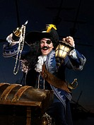 Pirate with a lantern opening a treasure chest