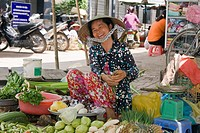 Market vendor selling goods at the market in Cai Be, Mekong Delta, Vietnam, Southeast Asia