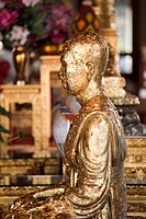 Statue of a monk decorated with gold leaf, Wat Po Temple, Bangkok, Thailand, Asia