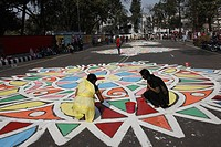 "Students of Fine Art Institute of Dhaka University paint floral motifs at the Central Shaheed Minar, ""Language Martyrs' Monument' area in observance o..."