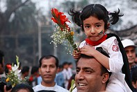 "A girl child with his father arrives for place wreaths at the ""Central Shaheed Minar"" Language Martyrs´ Monument on the occasion of International Moth..."