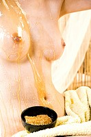 Woman applying honey into skin