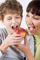 mother and child eating apple