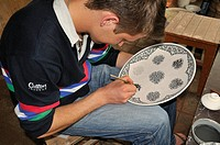 Uzbek man painting pottery, Fergana Valley, Uzbekistan, Central Asia