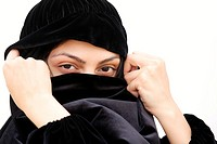 Woman in shawl covering face